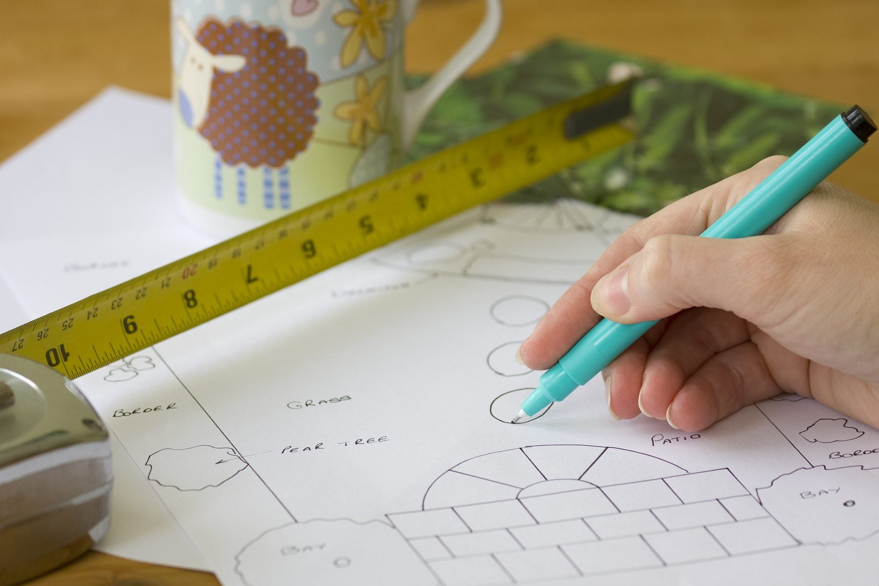 Image of a designer putting together a simple garden plan